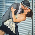 Engaged-couple-kissing-Austin