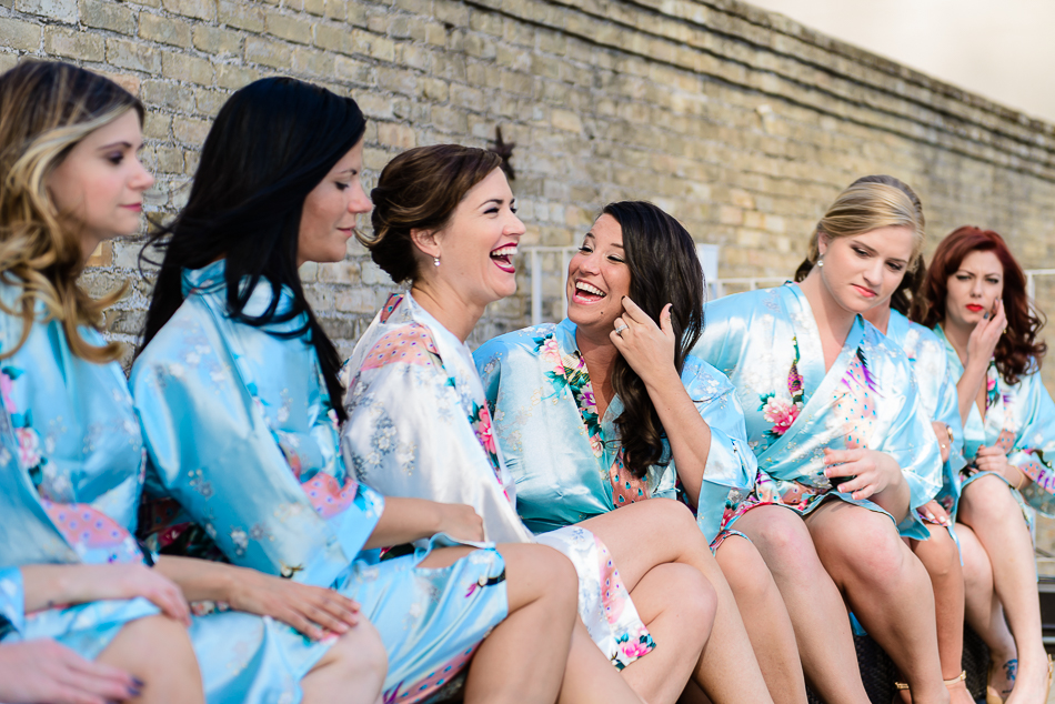 bridal party wearing Blue silk robes while getting ready at The Belmont in austin texas by wedding photographer