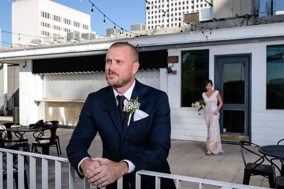 stylish groom waiting for bride during first look upstairs at the Belmont by austin wedding photographer