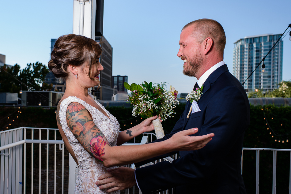 Portrait of tattooed bride and groom first look, urban wedding downtown austin wedding photography