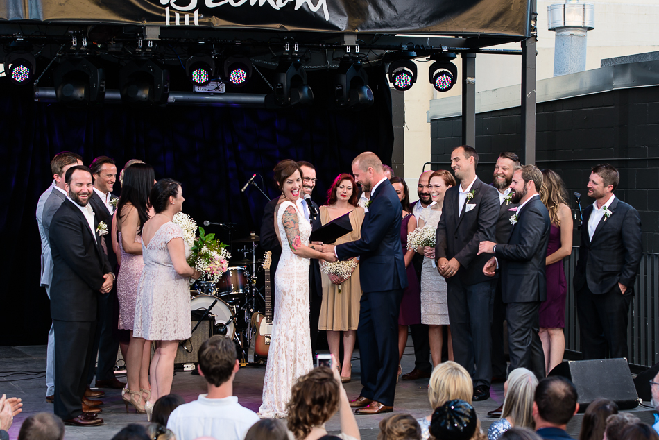 Ceremony on stage at live music venue in downtown austin by wedding photographer