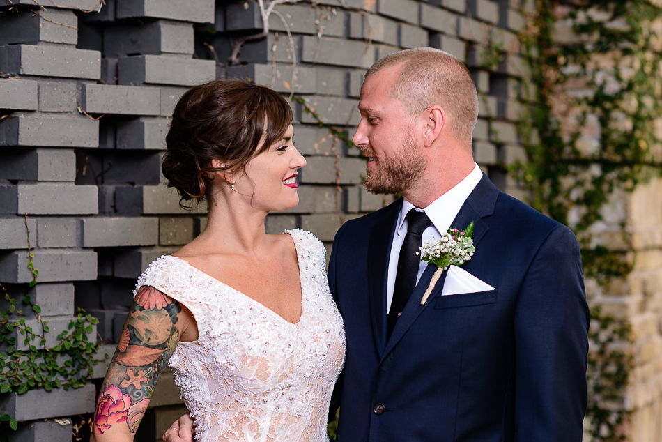 Tattooed austin bride with groom by wedding photographer at The Belmont