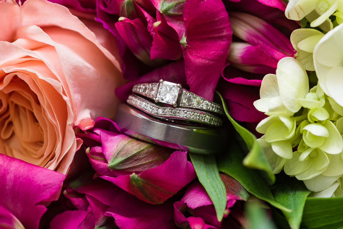 Diamond ring details with bouquet flowers by austin wedding photographers
