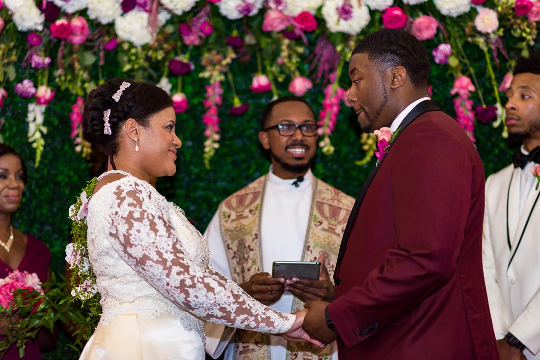 Austin wedding photographers ceremony flower wall pink flowers