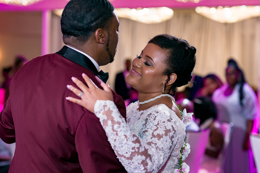 first dance with pink uplighting by austin wedding photographers
