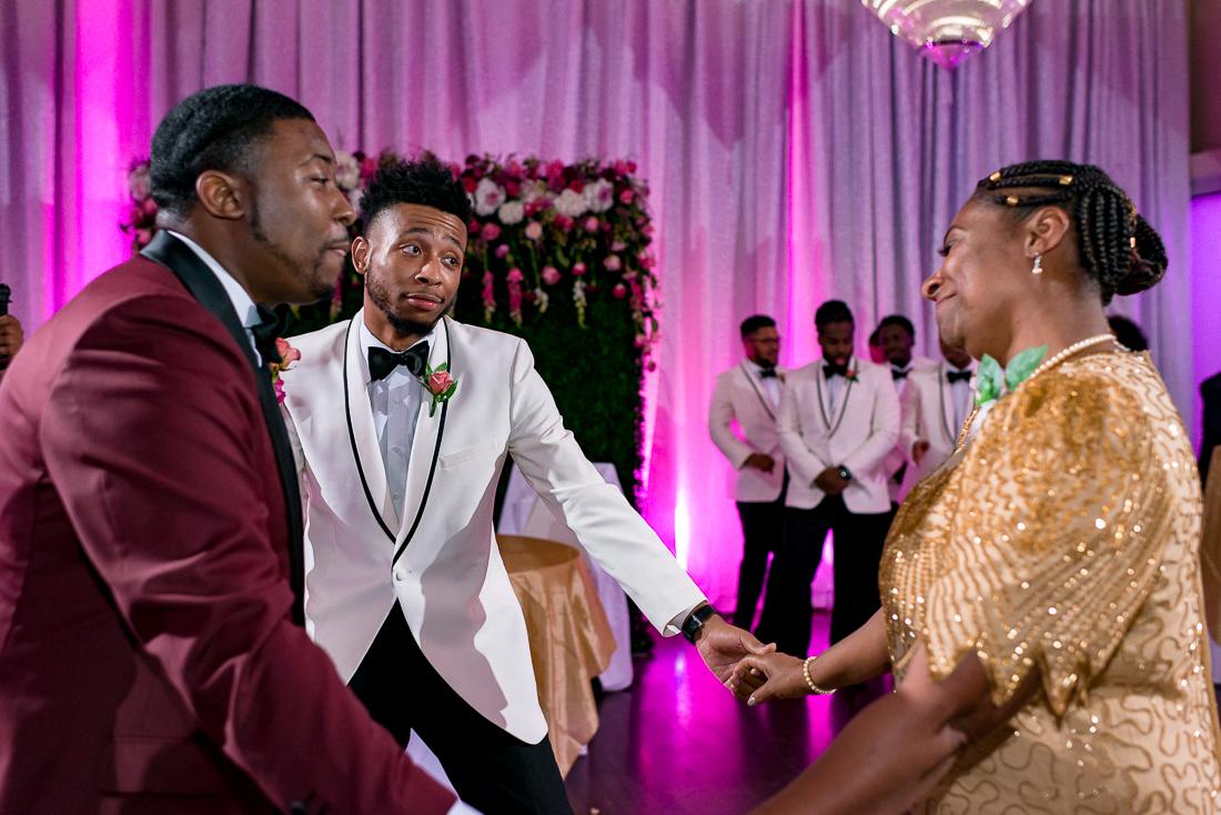 Black groom, african american wedding mother son dance by austin wedding photographers