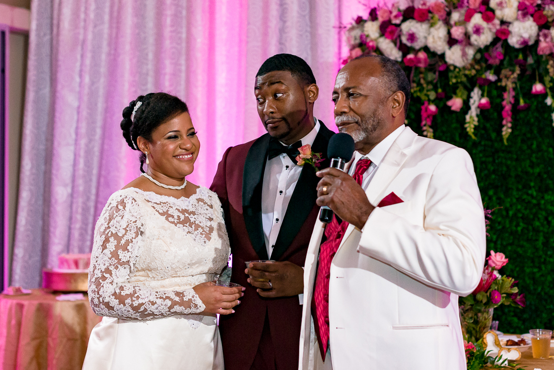 Father of black bride giving toast during reception by austin wedding photographers