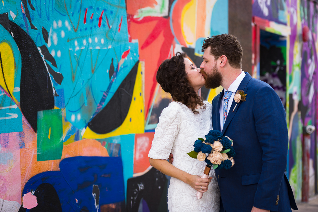 Austin-Wedding-Photographers-bride-downtown-mural-colorful-portrait