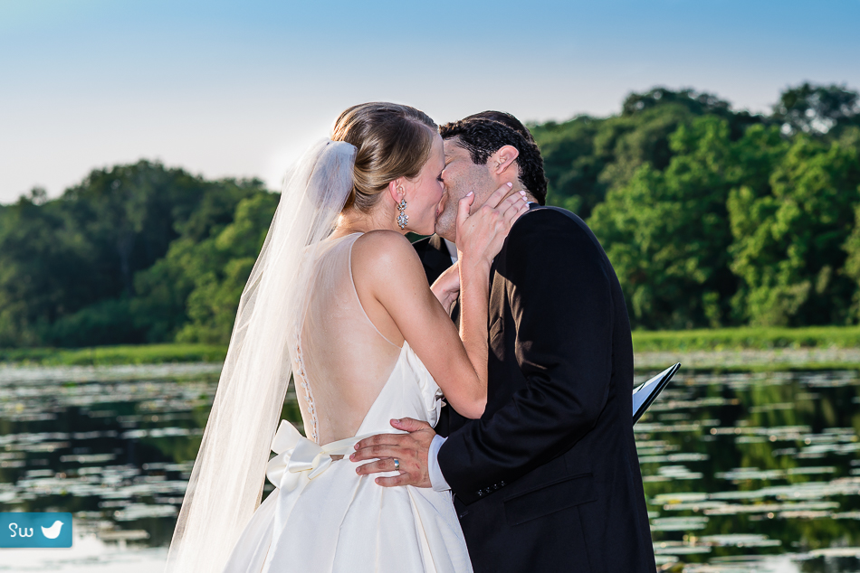 ceremony kiss of bride and groom by Austin Wedding Photographer