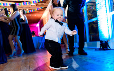 Photo of child dancing by austin wedding photographers at ZaZa Gardens in San Antonio