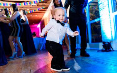 Photo of child dancing by austin wedding photographers at ZaZa Gardens in San Antonio
