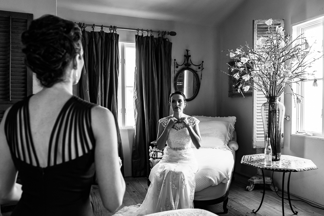Fine art portrait of bride getting ready with sister at Le San Michele venue