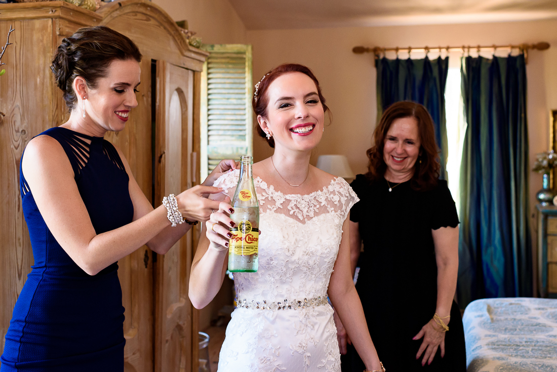 Topo Chico Bride getting ready Le San Michele by austin wedding photographers