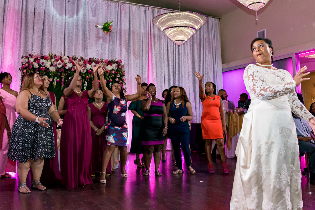Bouquet toss with black bride by austin wedding photographers