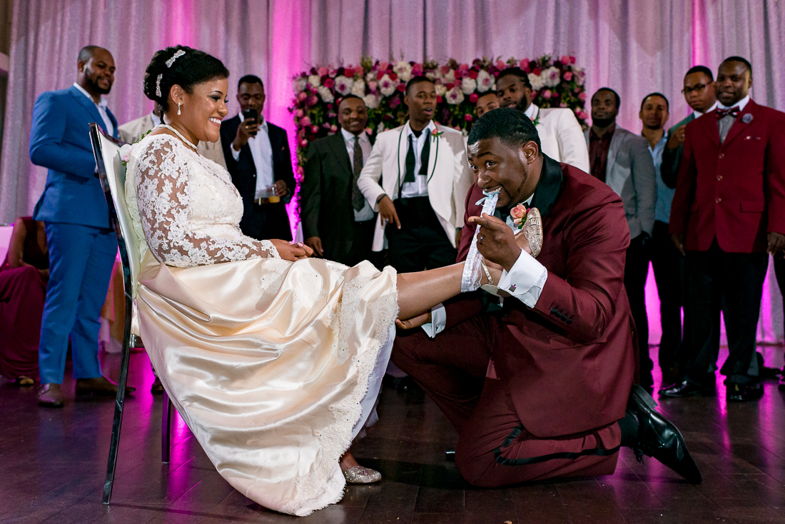 Garter toss at Sterling Events Center by austin wedding photographers