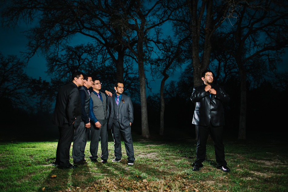 dramatic night portrait of groom and groomsmen at kindred oaks, bridal party