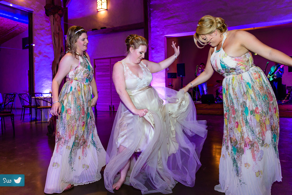 bridesmaids dancing by Austin Wedding Photographer at Barr Mansion