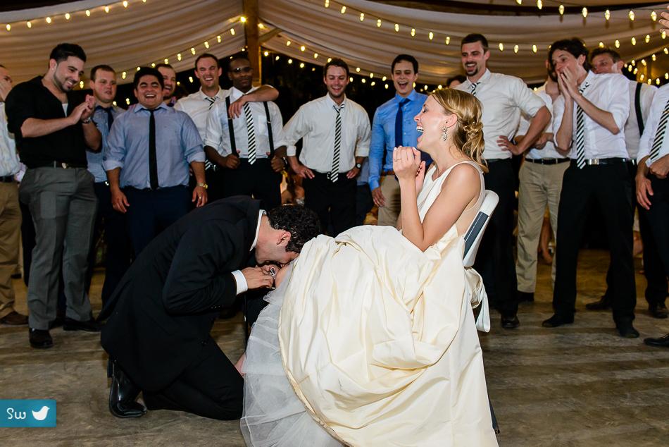 Austin Wedding Photographers garter with bride and groom