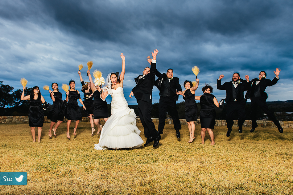 bride and groom with bridal party portrait in austin texas, dramatic winter wedding