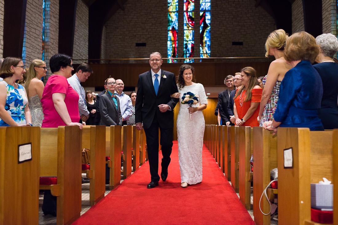ceremony-Austin-Wedding-Photographers-bride-father-central-church-presbyterian-aisle