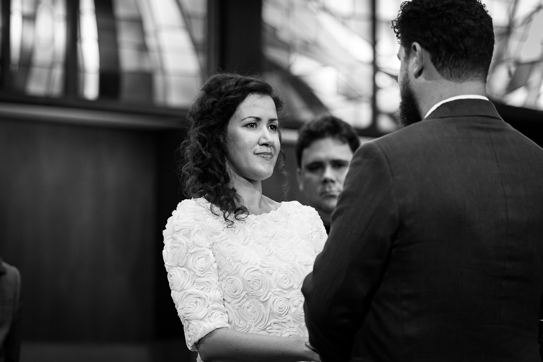 ceremony-Austin-Wedding-Photographers-dress-stained-glass-flowers-altar-central-presbyterian-church