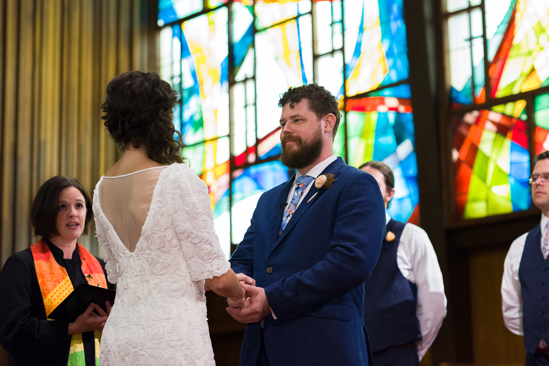 ceremony-Austin-Wedding-Photographers-groom-bride-glass-stained-officiant-central-presbyterian-church
