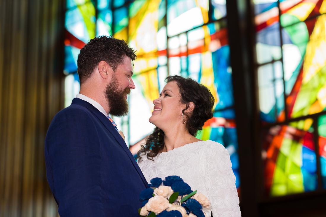 ceremony-Austin-Wedding-Photographers-portrait-stained-glass-windows-texas-central-presbyterian-church