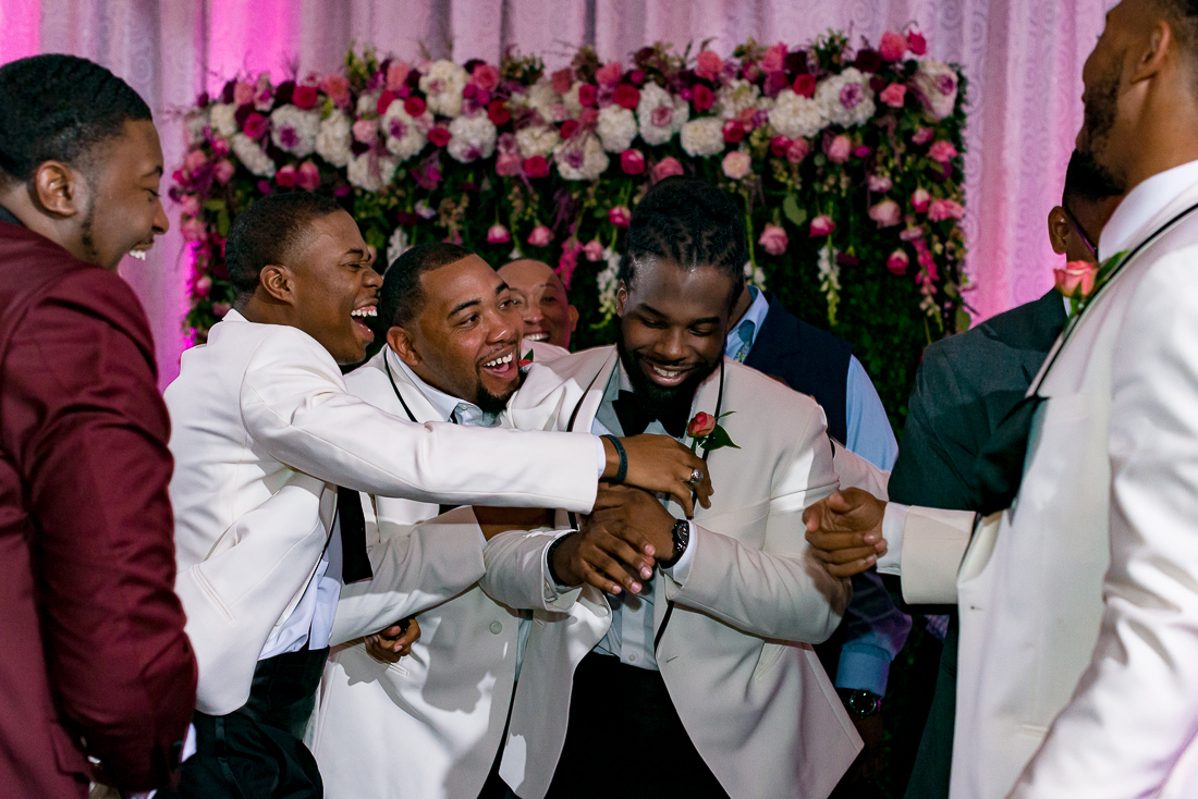 Black wedding party, garter toss by austin wedding photographers