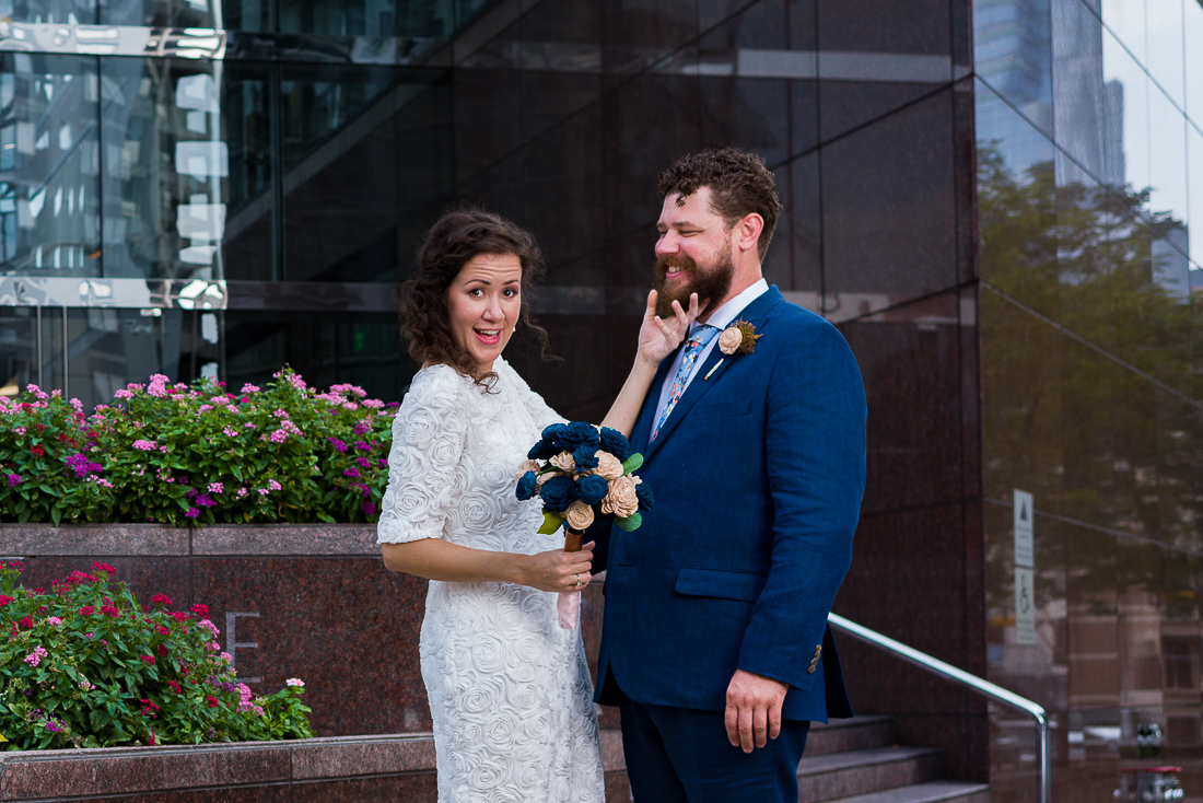 groom-bride-Austin-Wedding-Photographers-portraits-downtown-texas-couple-fun-flowers-city