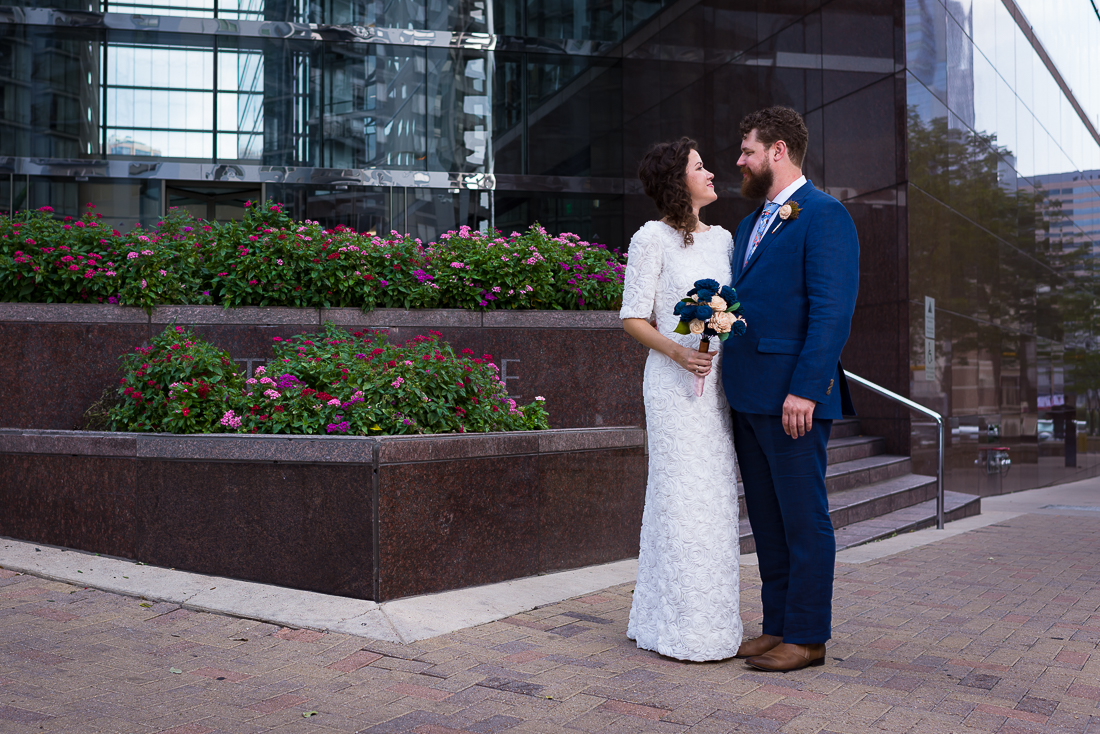 groom-bride-Austin-Wedding-Photographers-portraits-downtown-texas-couple-fun-groom