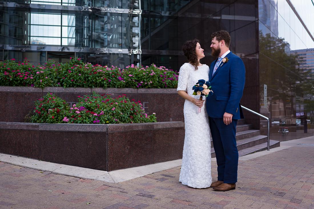 groom-bride-Austin-Wedding-Photographers-portraits-downtown-texas-couple-fun-groom