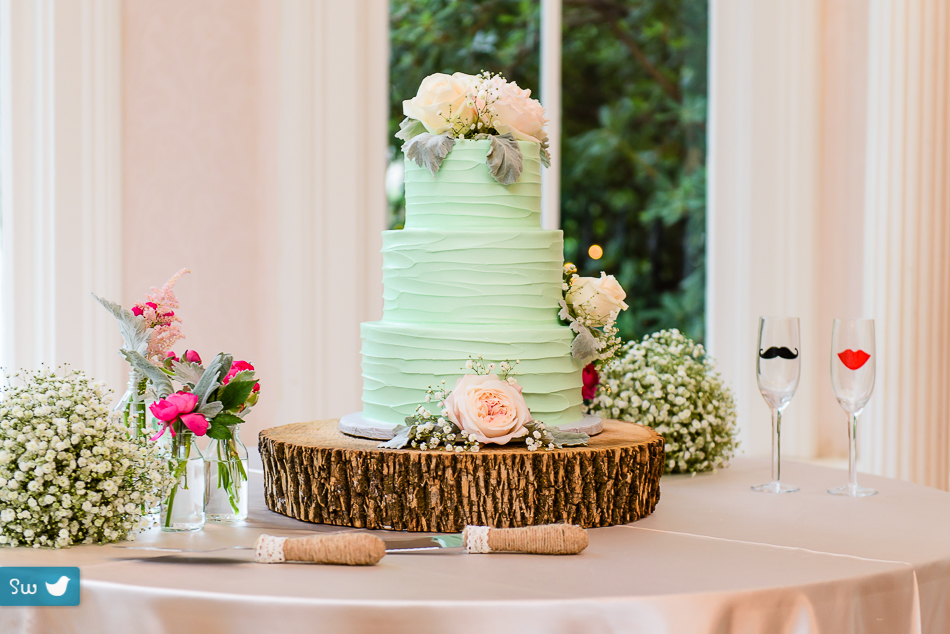mint green wedding cake with roses