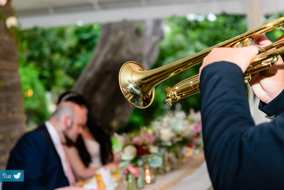mariachi trumpet player serenading bride and groom