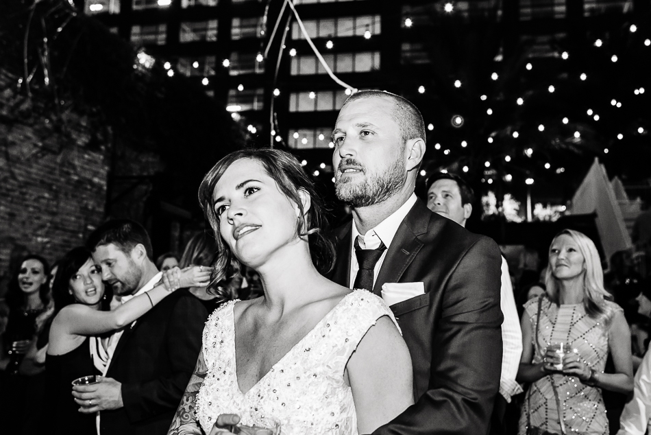Bride and groom watching live music by austin wedding reception