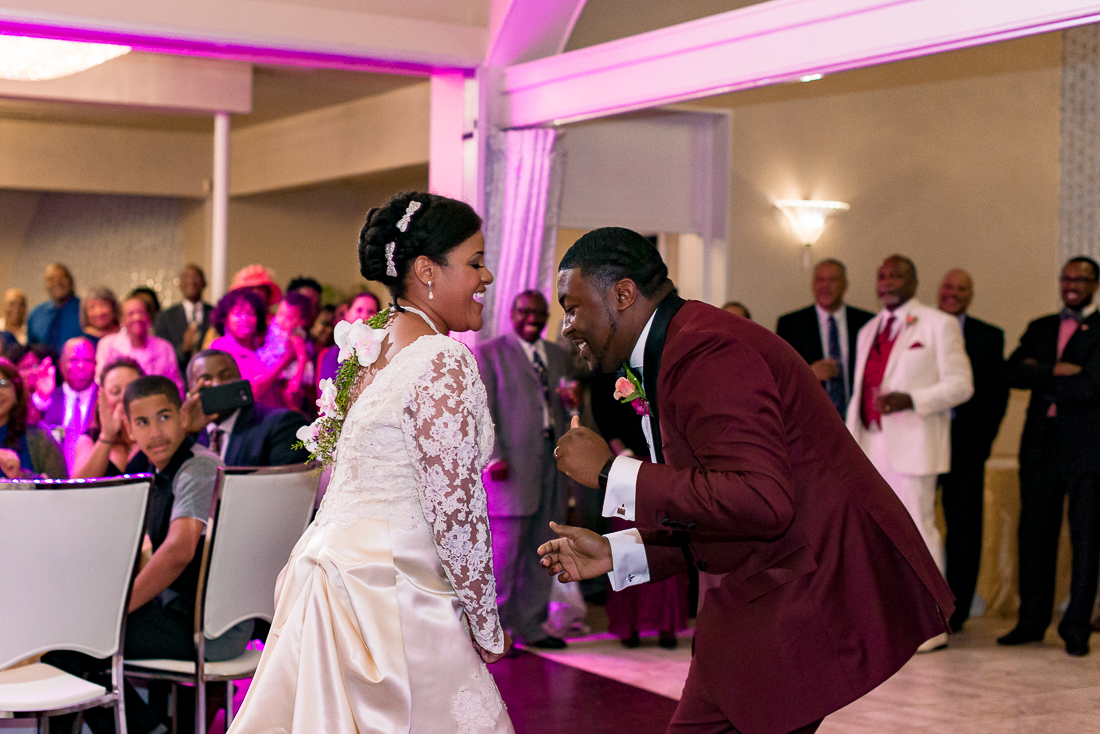 African American bride and groom dancing by austin wedding photographers