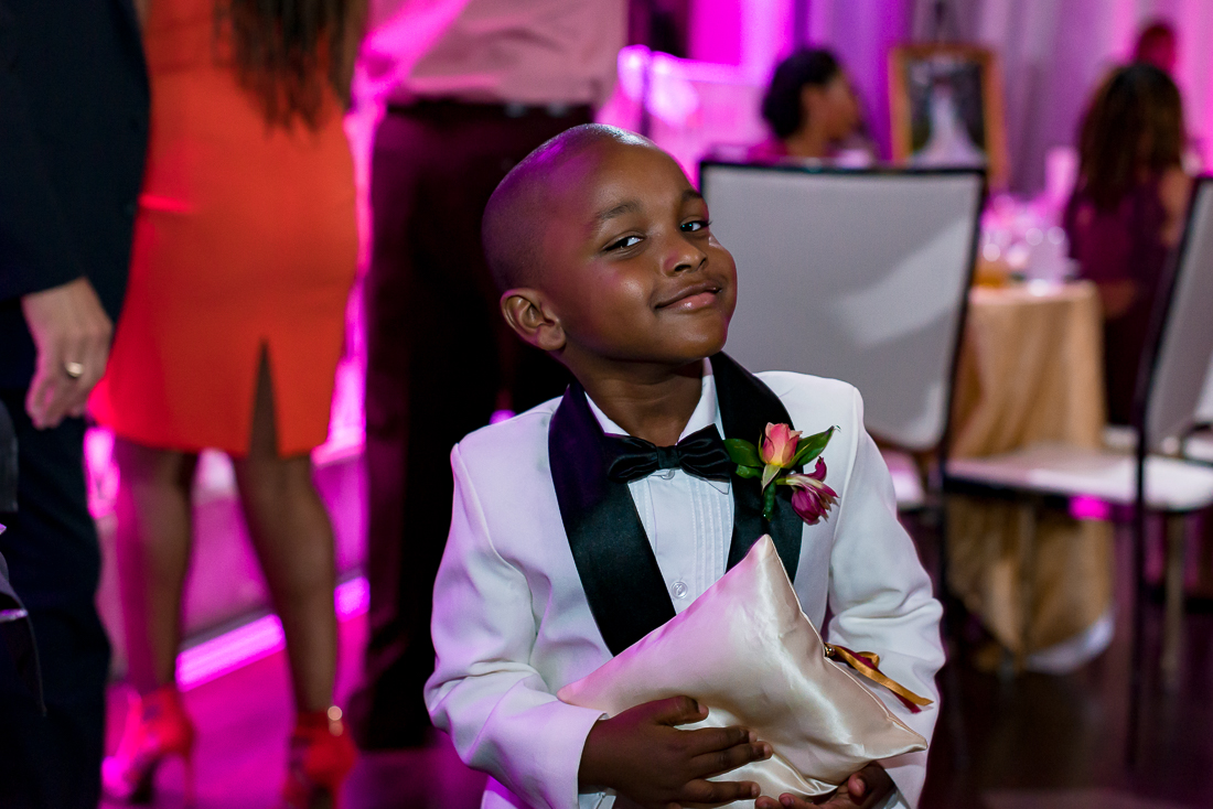 cute boy during reception at Sterling Events Center by austin wedding photographers