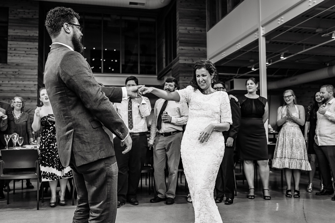 reception-Austin-Wedding-Photographers-bride-first-dance-bride-laughing-guests-texas-party