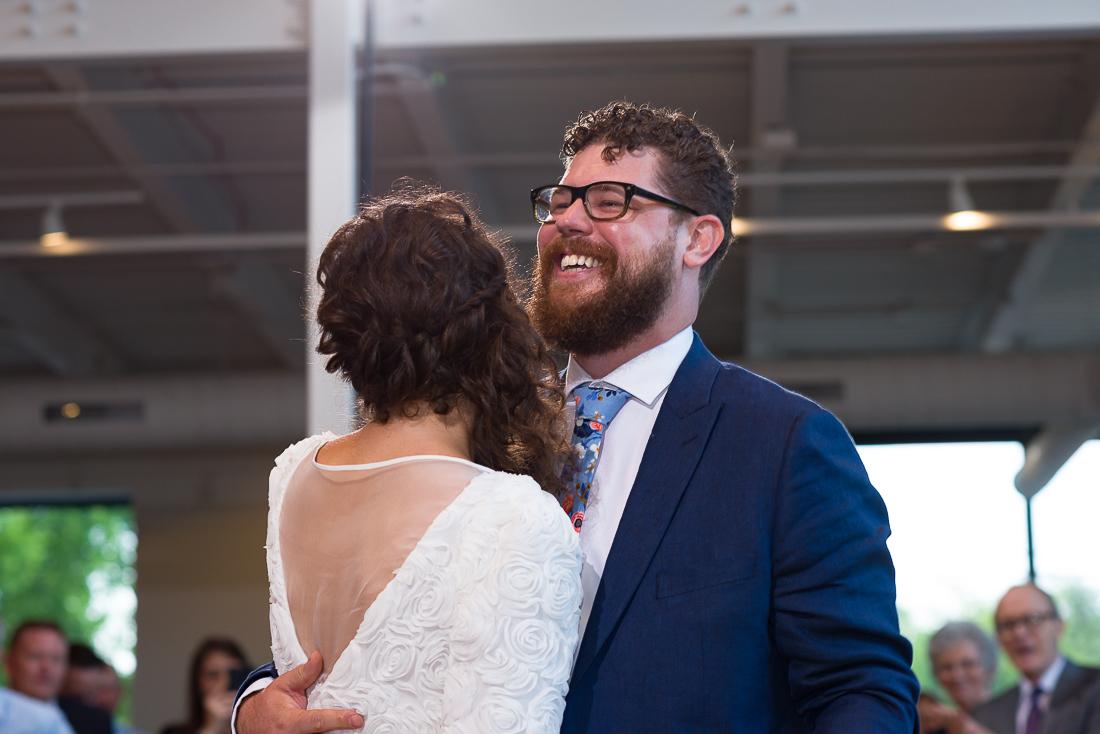 reception-Austin-Wedding-Photographers-bride-first-dance-groom-laughing