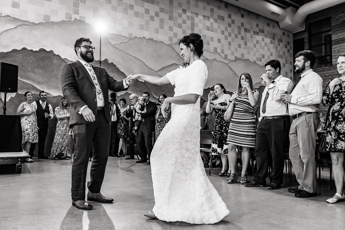 Austin-Wedding-Photographers-reception-bride-first-dance-laughing-guests-party