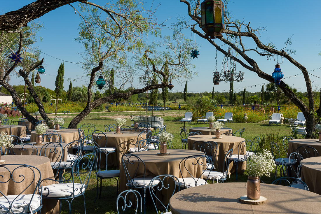 gold mason jars baby breath reception tables outdoor Le San Michele austin wedding photographers