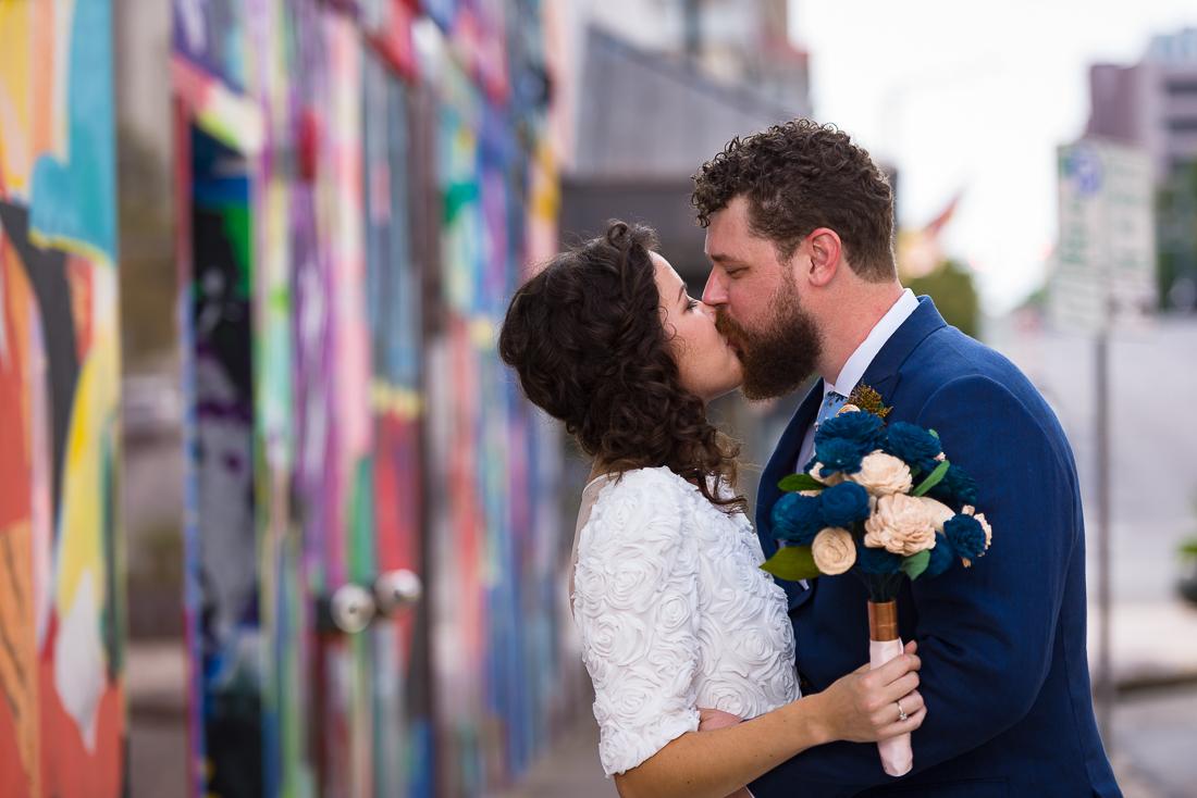 texas-Austin-Wedding-Photographers-kiss-portrait-mural-downtown-graffiti-street-bride-groom