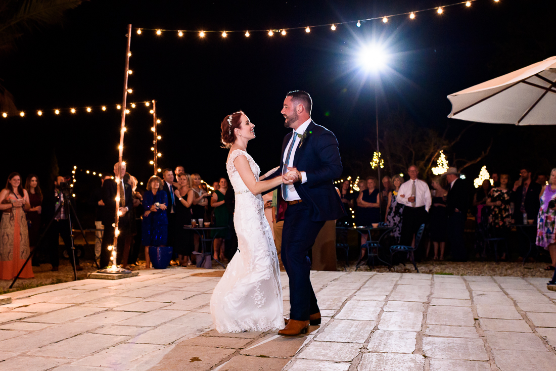 austin wedding photographers first dance outdoor evening night lights le san michele
