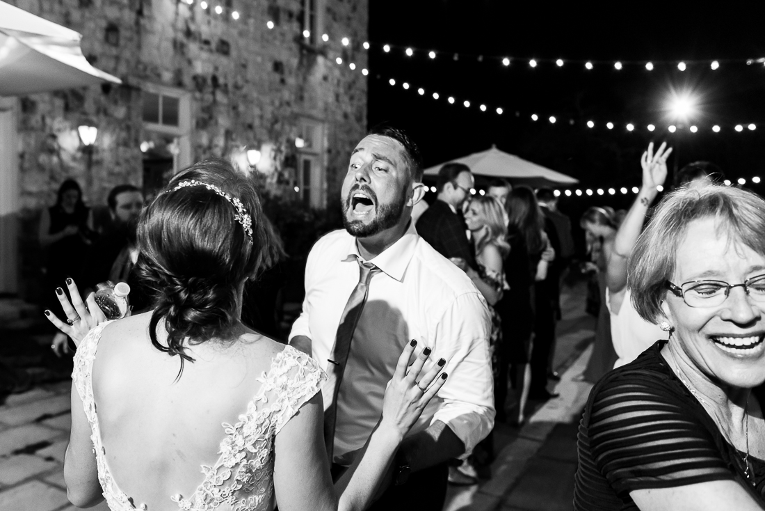 bride groom dancing outdoor night reception le san michele austin wedding photographers