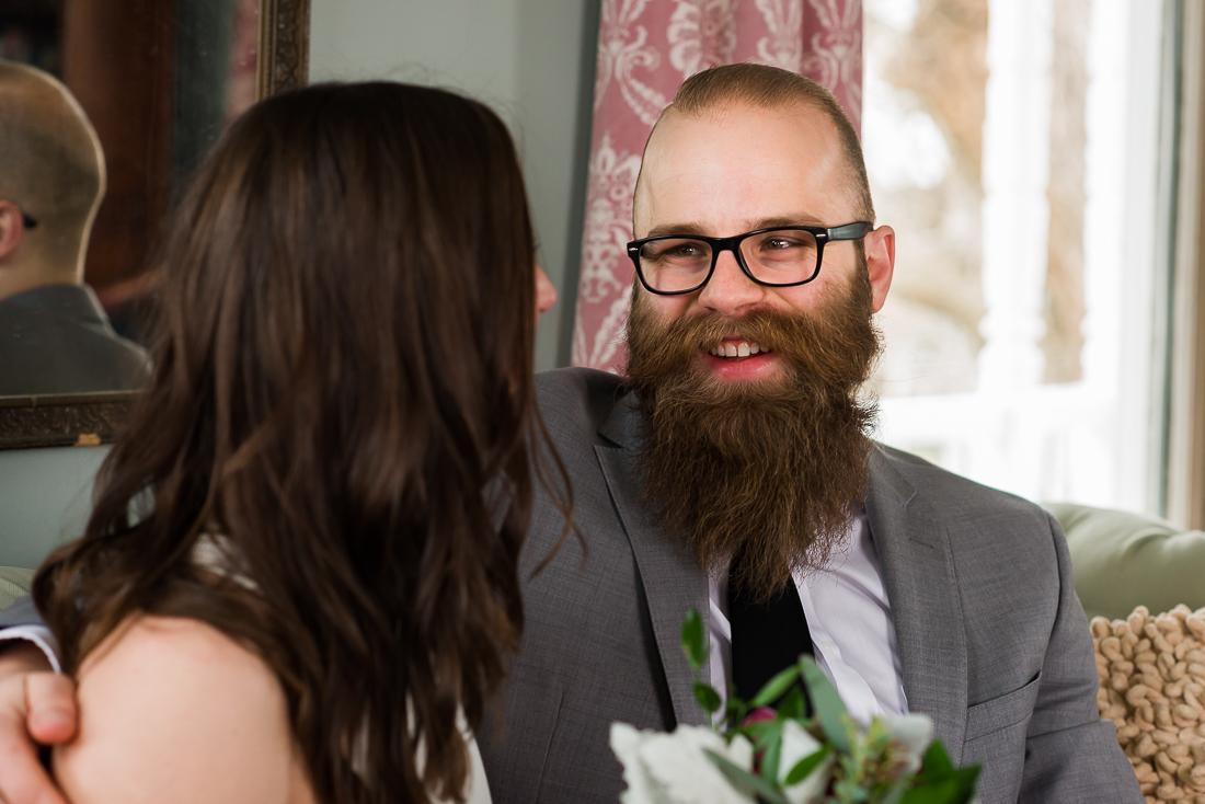 texas-barr-mansion-portraits-laughing-groom-Austin-wedding-photographers