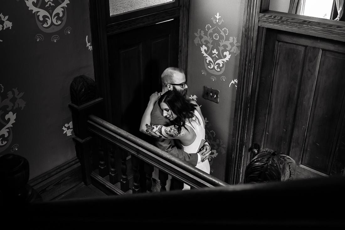tx-barr-mansion-tattooed-bride-groom-hug-portrait-Austin-wedding-photographers